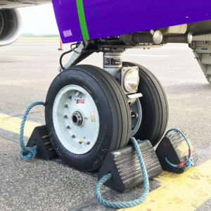 Glasgow, United Kingdom - June 5, 2016: Ryanair Boeing 737-800 parked at Glasgow International Airport. in the picture the detail of airplane front landing gear. Ryanair is the largest low-cost European airline by scheduled passengers carried.